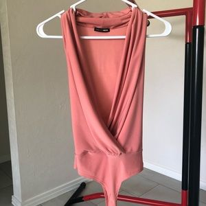 NWOT Surprise me body suit. Peach color.